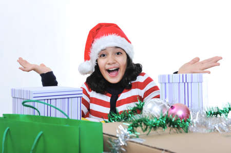 Happy girl with christmas present boxes photo