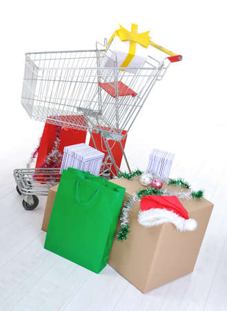 Shopping cart with boxes and bags, happy holidays photo