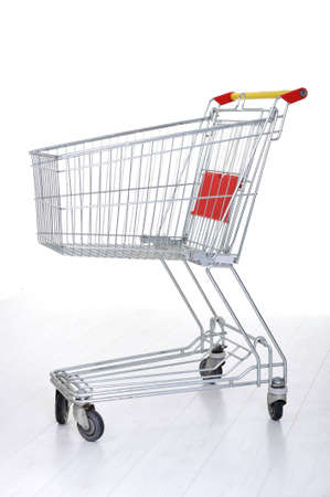 Shopping cart on white photo