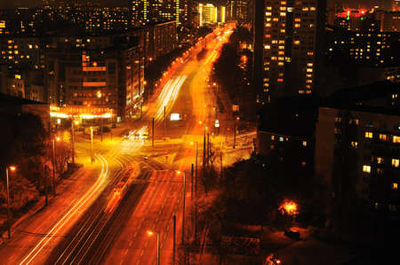 Modern Urban City at Night with Freeway Traffic