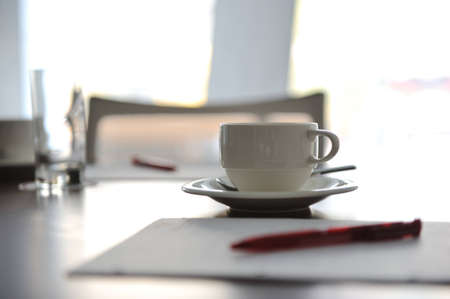 Cup of coffee on table in the conference room Stock Photo - 12627655