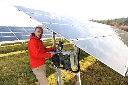 Man working with laptop at solar panels field Stock Photo - 12627113