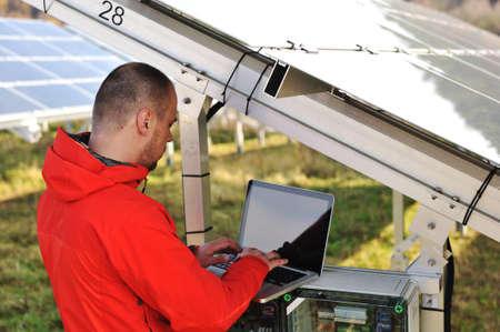 human energy: Engineer working with laptop by solar panels  Stock Photo