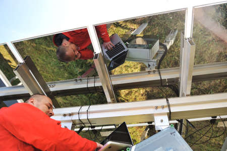 Engineer working with laptop repairing  solar panels Stock Photo - 12627158
