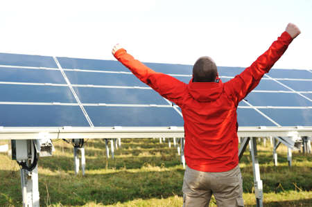 Success, engineer in solar panel fields opening arms up photo