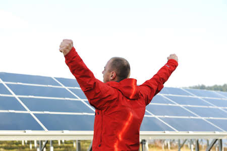 Success, engineer in solar panel fields opening arms up Stock Photo - 12627665