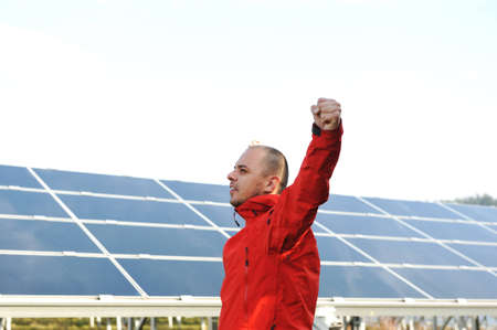 Success, engineer in solar panel fields opening arms up Stock Photo - 12627645