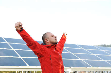 Success, engineer in solar panel fields opening arms up Stock Photo - 12627648