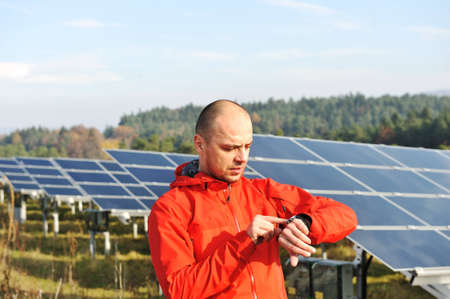 Male worker at solar panel field photo