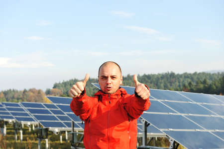 Male worker at solar panel field Stock Photo - 12627522