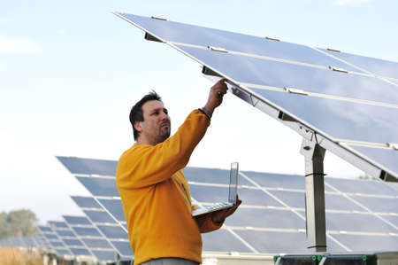 Young expert working at solar panels Stock Photo - 12627552