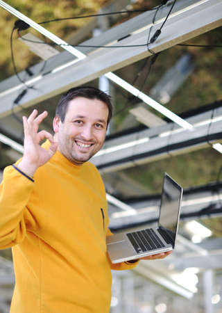 formwork: Engineer using laptop at factory Stock Photo