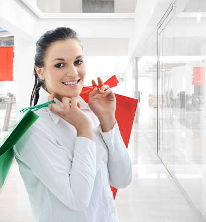 Woman with shopping bags at mall photo