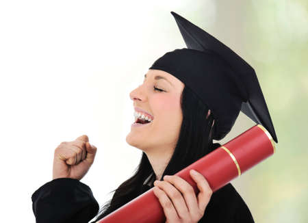 Graduating glory and pride, happy female with diploma in hands photo