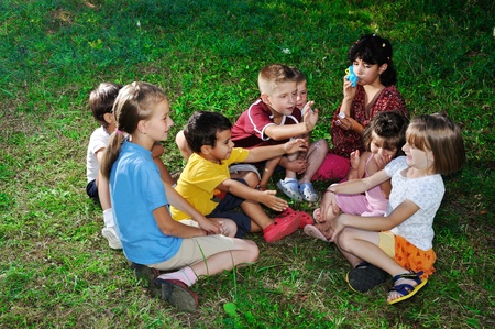 Photo of happy kids playing and blowing soap bubbles Stock Photo - 13375486