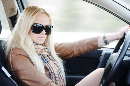 Beautiful blonde girl in her car photo