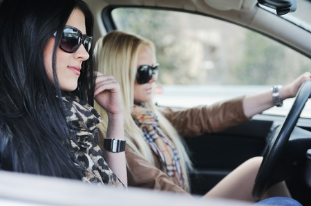 Two girls in a car photo