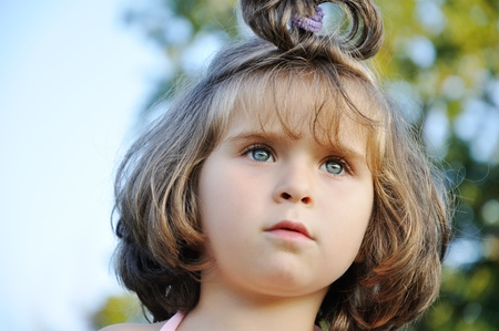 Cute little girl in nature Stock Photo - 13375482