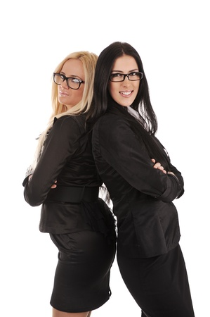 Two business woman standing back-to-back over white background photo