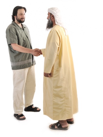 Arabic Muslim businessman shaking hands photo