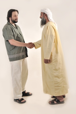 Arabic Muslim businessman person shaking hands photo