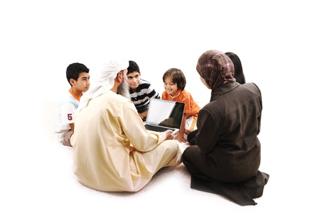 Arabic Muslim teacher with children students photo