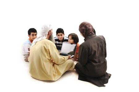 Teacher with children using laptop photo