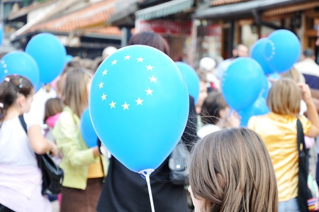 unification: Group of teenage people holding eu balloons