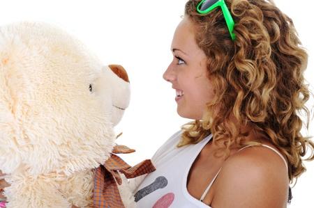 Teenage girl holding a teddy bear (no name or trademark) photo