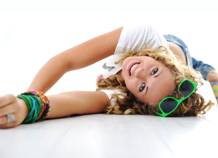 upside down: Teen cute girl with curly hair lying on floor
