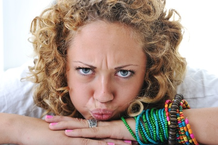 angry blonde: Teen girl with angry grimace
