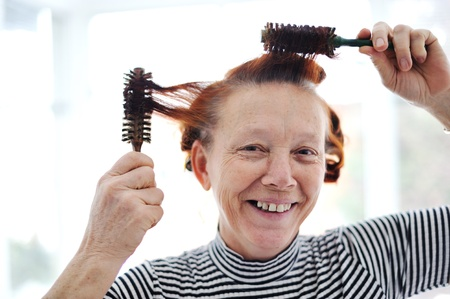 Senior lady hairdressing with many combs Stock Photo - 13381911