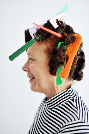 Senior woman with many combs on hair photo