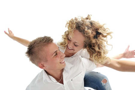 Portrait of a romantic young couple smiling together over white background Stock Photo - 13381942