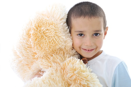 Portrait of a little kid with bear toy isolated in white photo