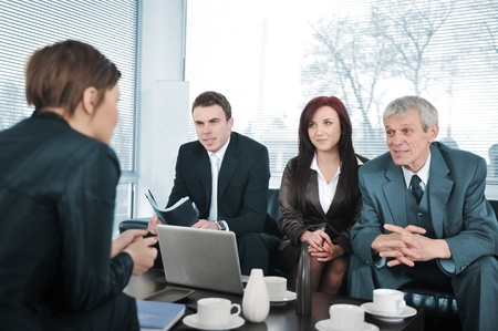 finance director: Businesswoman in an interview with three business people