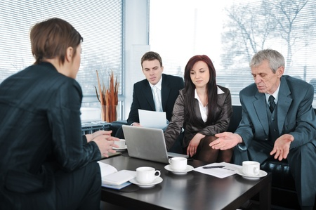finance director: Businesswoman in an interview with three business people getting bad results Stock Photo