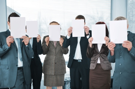 Business team holding white papers in office photo