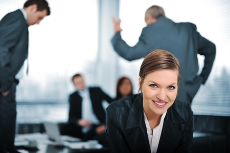 Young businesswoman with colleagues in background photo