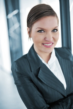 Beautiful businesswoman in office smiling Stock Photo - 13381929