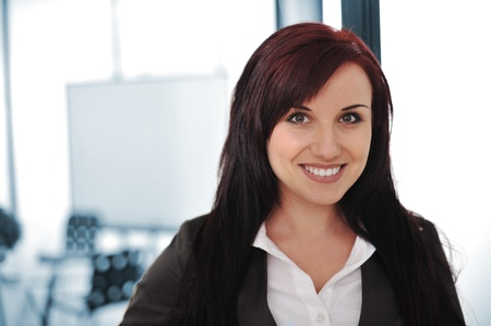Cute young businesswoman in her office photo