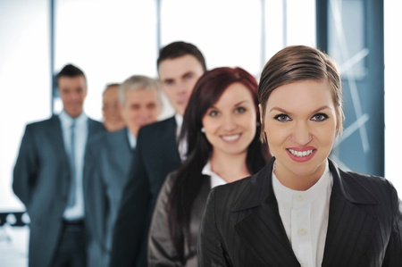 Group of business people standing in line photo