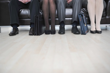 Business people sitting on couch photo