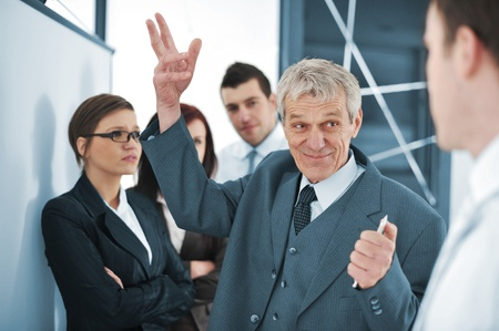 Business team discussing a project with boss Stock Photo - 13381915