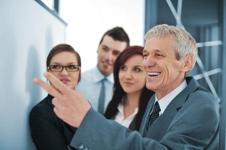 Boss explaining graph to his team Stock Photo - 13381926