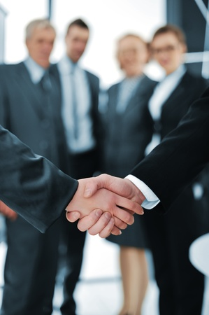 business contract: Handshake isolated on business background