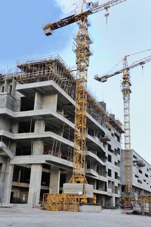 scaffold: Construction site with crane and building