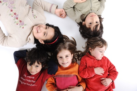 Children group in circle laying on ground Stock Photo - 13687080
