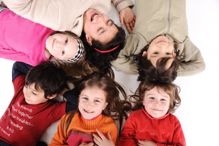 Children group in circle laying on ground photo