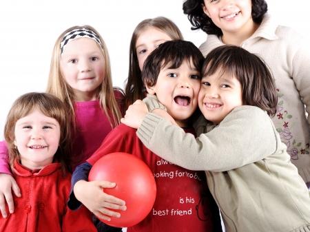 Group of happy playful children in studio photo